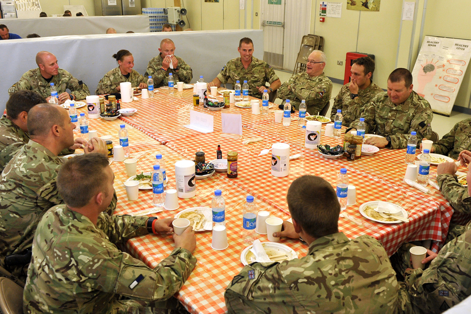 General Wall has supper with a group of soldiers