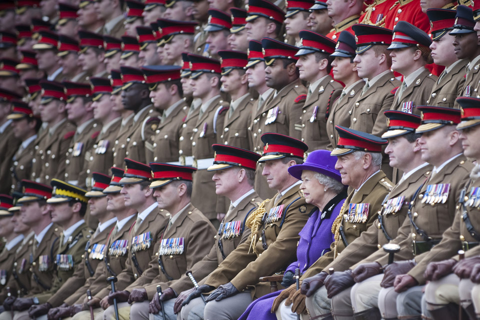 Her Majesty poses for a photograph with members of the Household Cavalry regiments