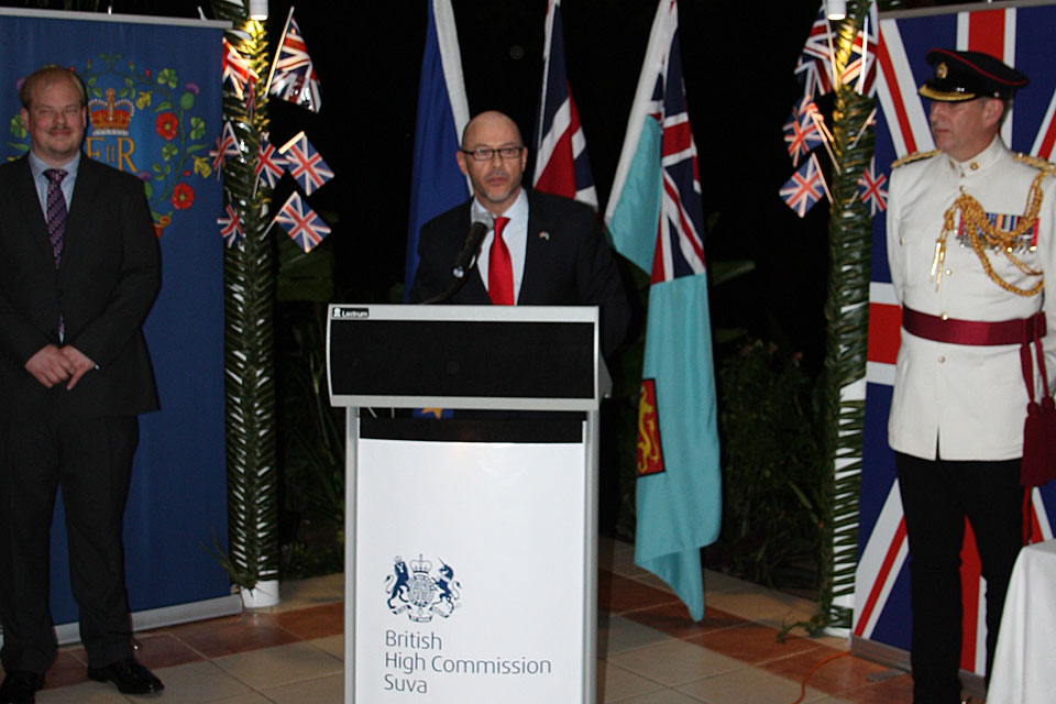 Steven Chandler Acting High Commissioner delivers his speech at the Queen's Birthday Party. Standing on his left is Lieutenant-Colonel Tim Woodman (Wellington-based UK Defence Attaché) and on his right is Dan Salter (Deputy High Commissioner).