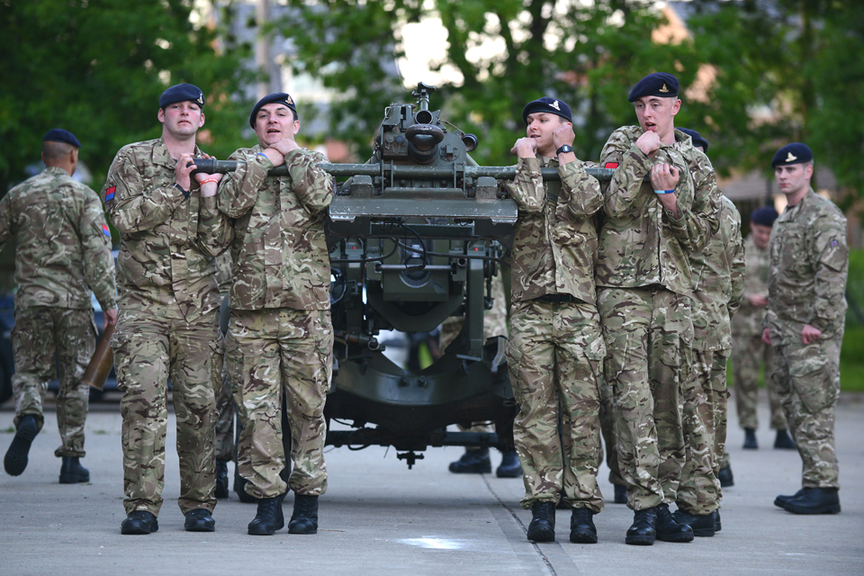 TA soldiers manoeuvre their 105-millimetre light gun into position