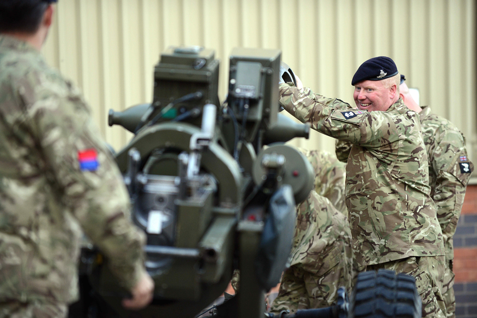 TA soldiers prepare their 105-millimetre light gun for firing