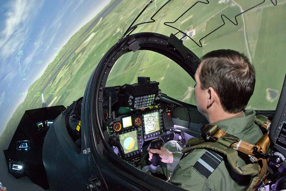 A pilot demonstrates a Hawk fast jet simulator