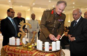 Brigadier Greville Bibby lights a candle for Diwali