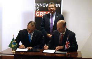 Glaucius Oliveira, Ambassador Alan Charton (standing), Steve Visscher