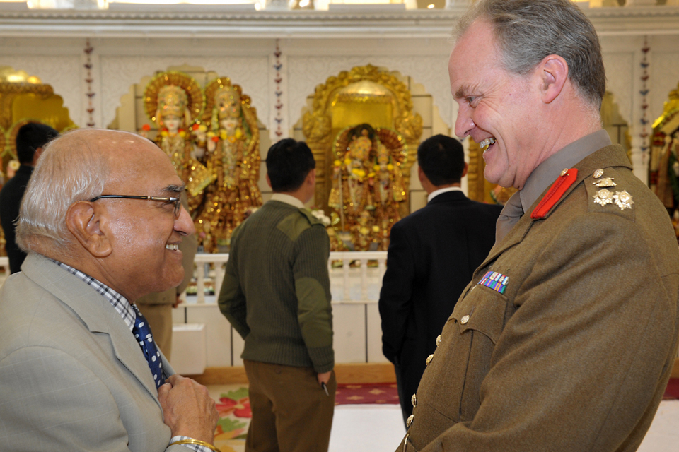 Brigadier Greville Bibby shares a joke with Dr Achhar Paul Dharni