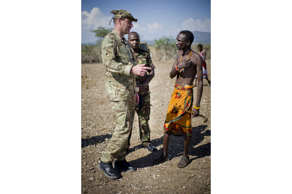 A member of the Military Stabilisation Support Group engaging with a Kenyan man