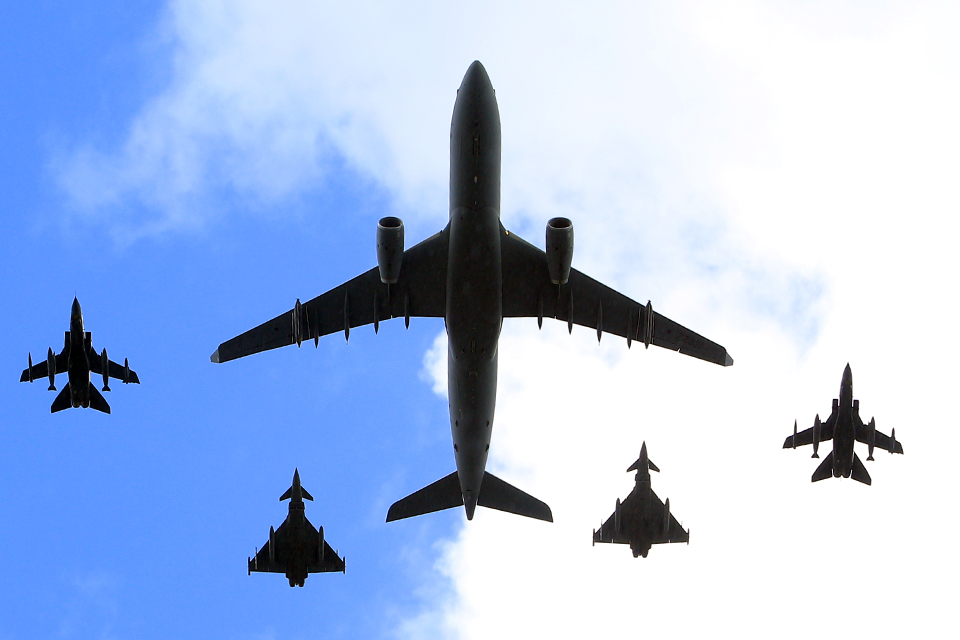 RAF Voyager escorted by Typhoon and Tornado fighter jets