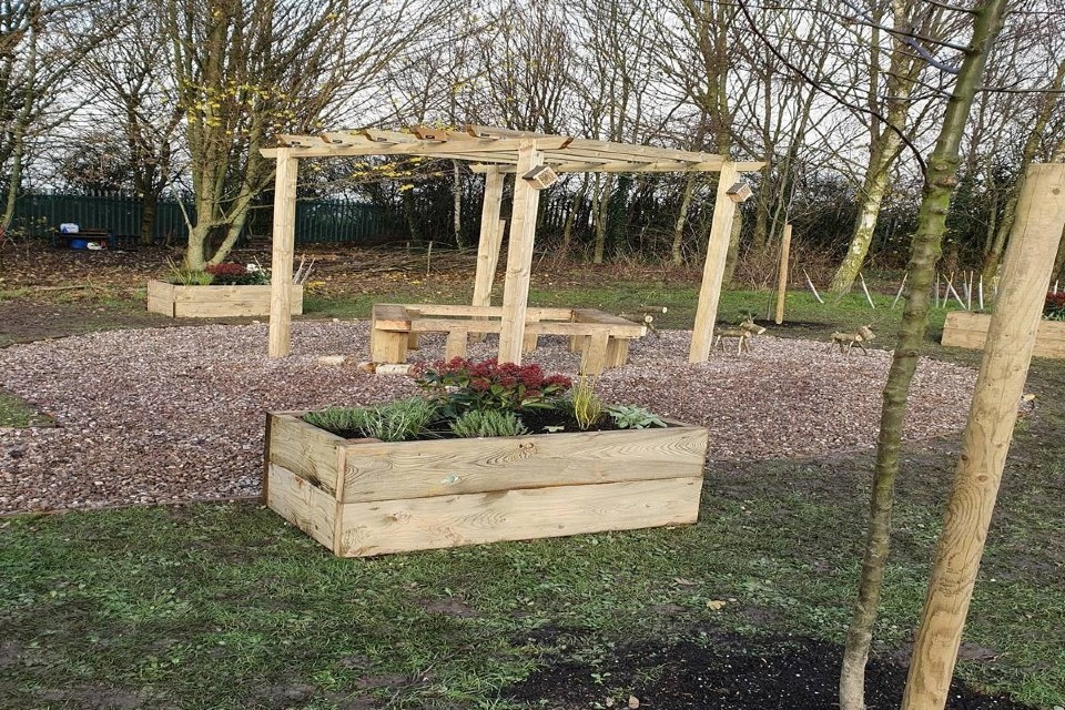 The garden transformed through the Highways England charity challenge.