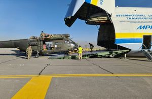 Puma helicopter being loaded off an Antonov aircraft at RAF Benson