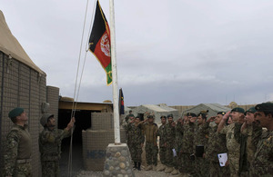 The Afghan flag is raised at a patrol base north of Gereshk in Helmand province (library image)