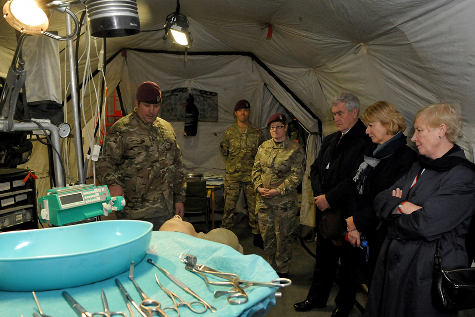 Staff Sergeant Dean Cullen briefs Sir John Ashworth, Julie Firth and Dr Sally Irvine