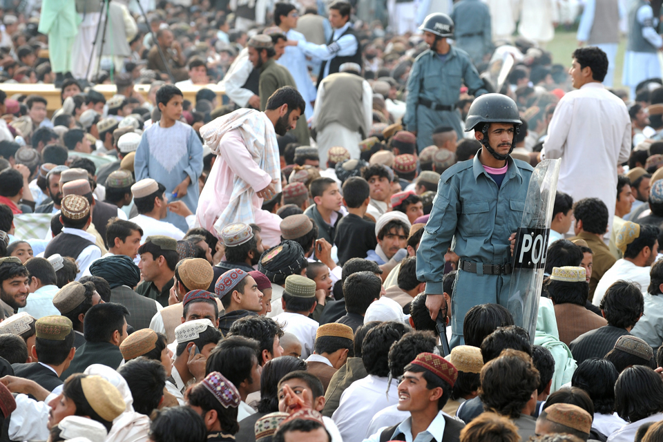 Afghan policemen carry out security duties