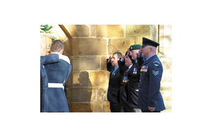 Veterans and serving personnel salute the coffin of Sir Rex Hunt