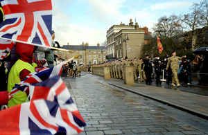 Crowds cheer passing soldiers