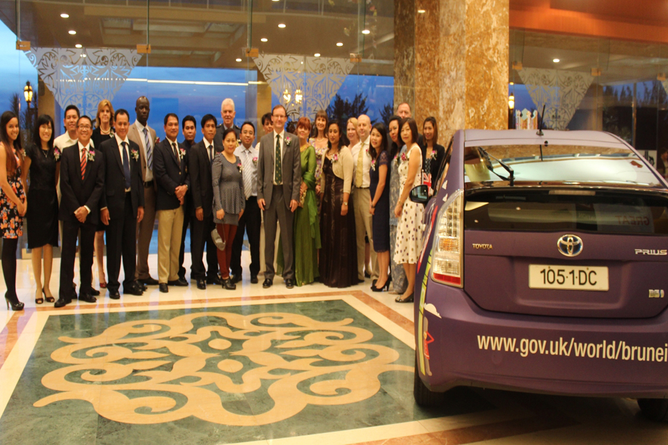 Members of staff of the British High Commission with the newly designed hybrid Prius