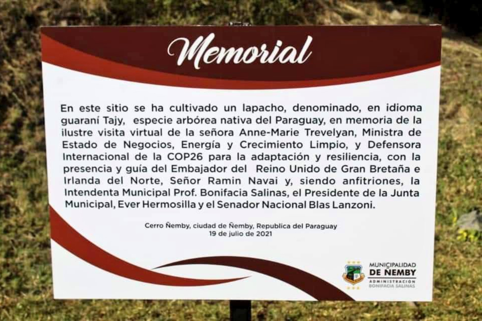 Close up of memorial sign at tree planting site.