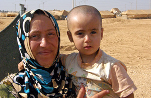 A mother and her 2 year old daughter at the Za'atari refugee camp in Jordan