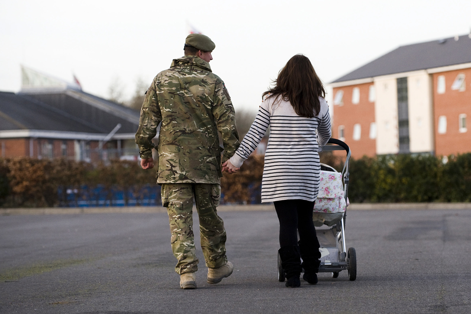 A soldier heads home with his family