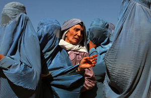 Women line up to collect bags of split chick pea, wheat, and cooking oil being distributed by the UN World Food Programme (WFP) in Herat, Afghanistan. Picture: UN Photo/Eric Kanalstein