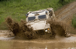 Husky protected support vehicle tackles the deep water obstacle at the Millbrook Proving Ground, Bedfordshire [Picture: Kathryn Stewart, Crown copyright]