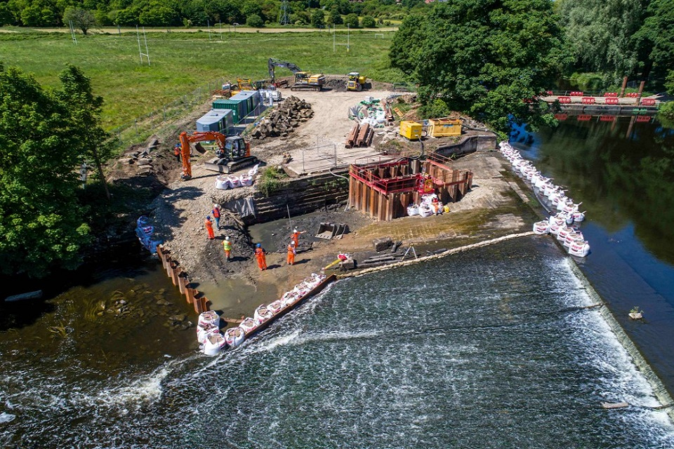 The image shows the Kirkstall weir fish pass as part of the DNAire project.