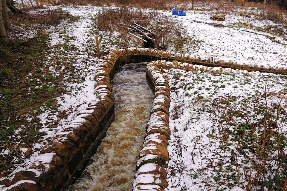 The image shows the completed fish pass on the River Aln