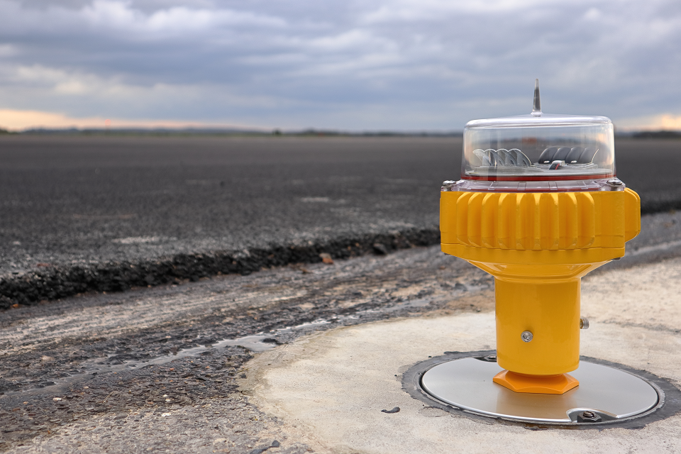 One of the new airfield ground lights at RAF Odiham, next to the resurfaced runway.