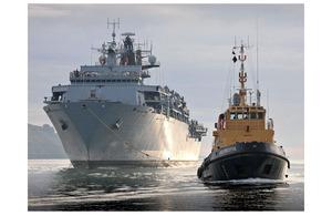 HMS Bulwark and a tug