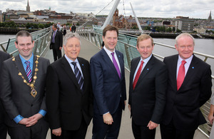 The Mayor of Derry, Councillor Martin Reilly, Northern Ireland First Minister Peter Robinson, Deputy Prime Minister Nick Clegg, Irish Taoiseach Enda Kenny and Deputy First Minister Martin McGuinness on the Peace Bridge in Londonderry following the British