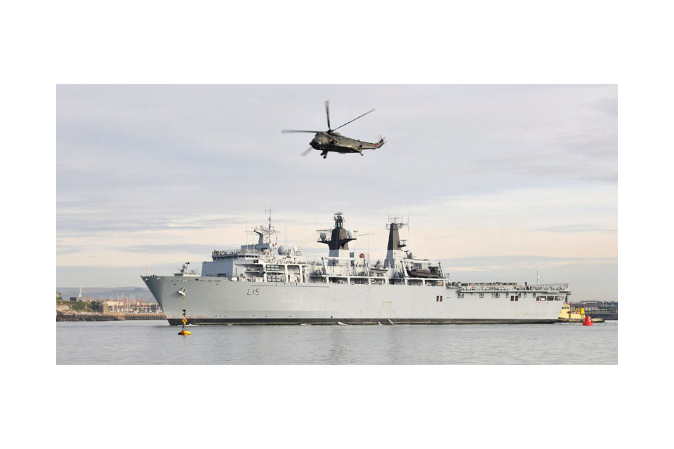 Sea King helicopter flies over HMS Bulwark