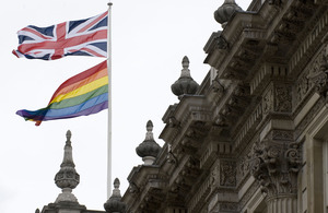 A flag flies for Pride on Whitehall.
