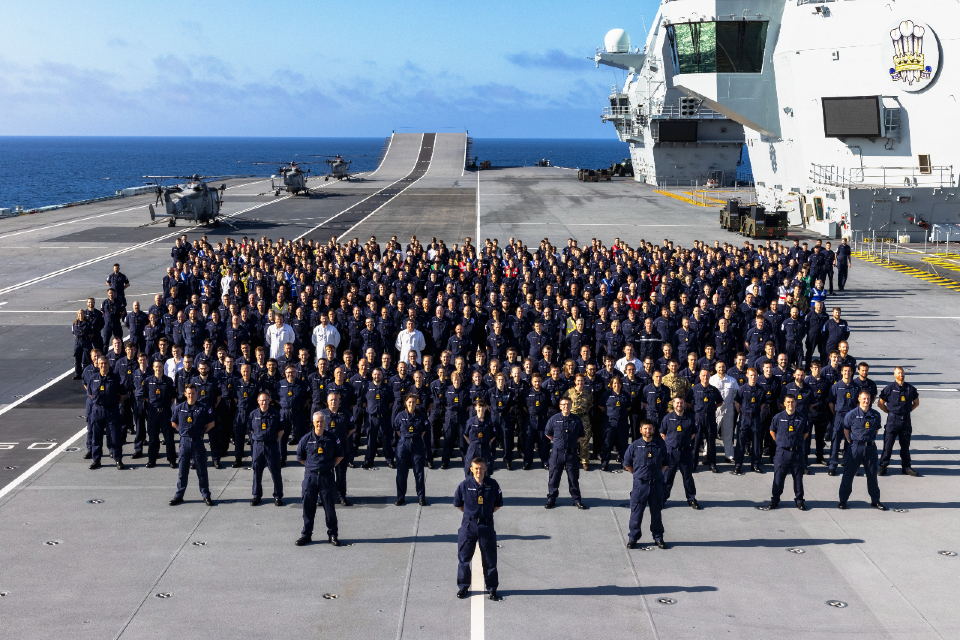 Royal Navy personnel on the deck of an aircraft carrier