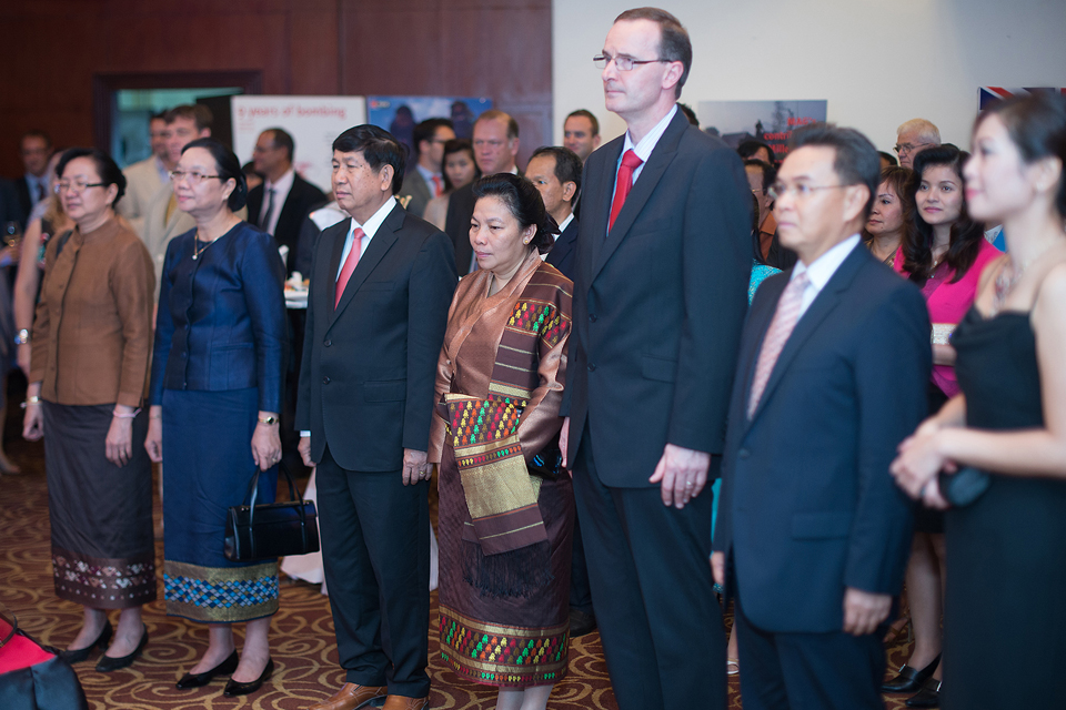 Ambassador Philip Malone at The Queen's Birthday Party with His Excellency, Dr. Xaysomphone Phomvihan, Vice President of the National Assembly, Her Excellency Dr. Sounthone Xayachack, Vice Minister of Foreign Affairs