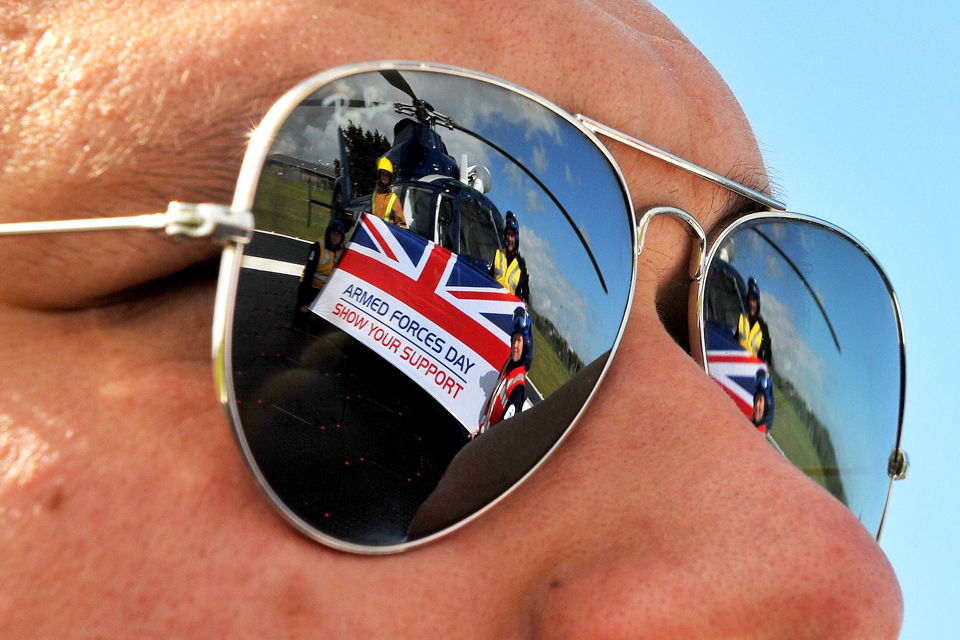 Members of the Flag Officer Sea Training aviation department refelected in a pair of sunglasses