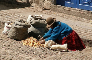 Woman selling potatoes, Pisac, Peru