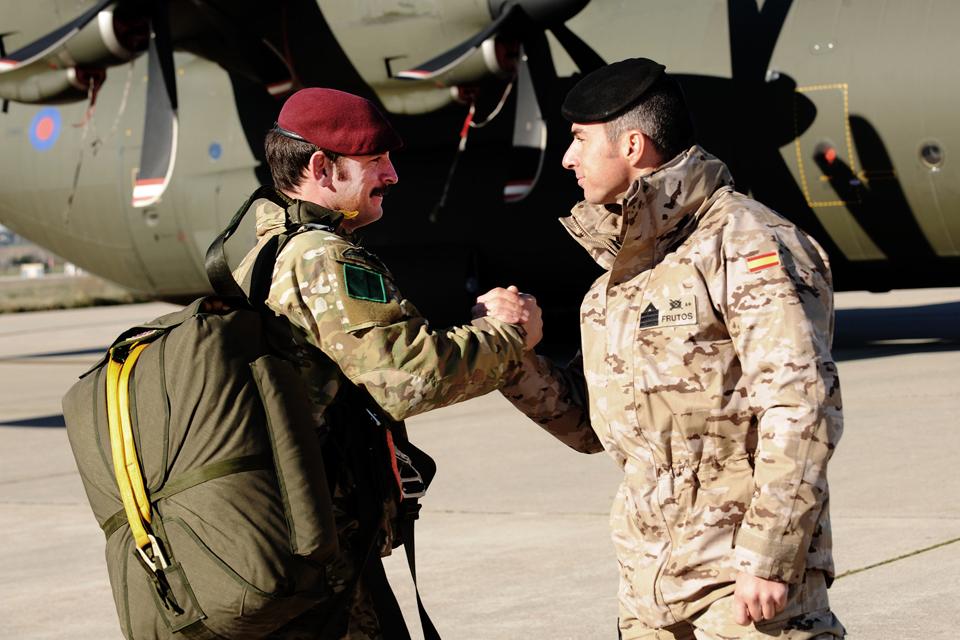 Sergeant Gaz McMahon greets Staff Sergeant Ignacio Gonzalez Frutos