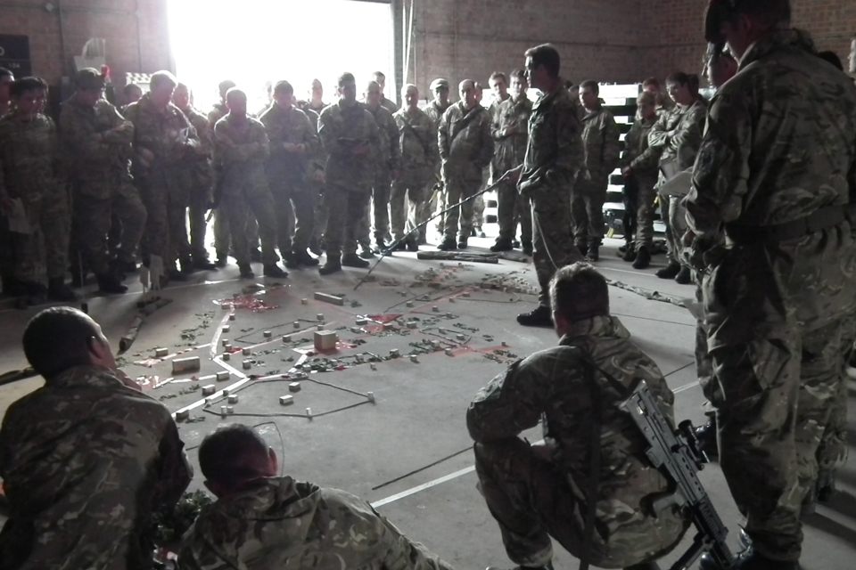 Troops being briefed before taking part in Exercise Wessex Thunder