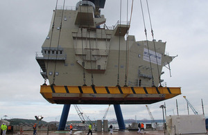 The aft island of HMS Queen Elizabeth about to be lowered into place [Picture: Crown copyright]