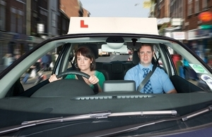 Learner driver and instrutor in car
