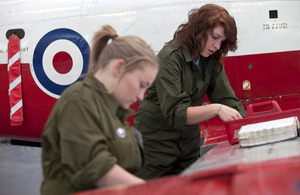 Young people repairing an aeroplane