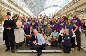 Don Foster with performers at St Pancras Station