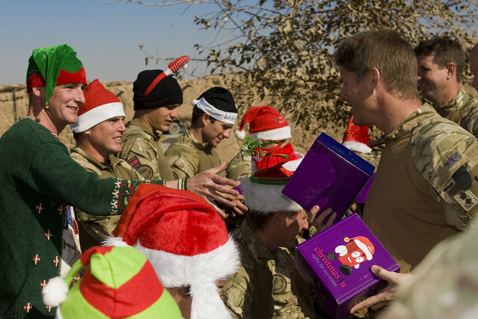 Christmas Boxes being handed to soldiers in Afghanistan
