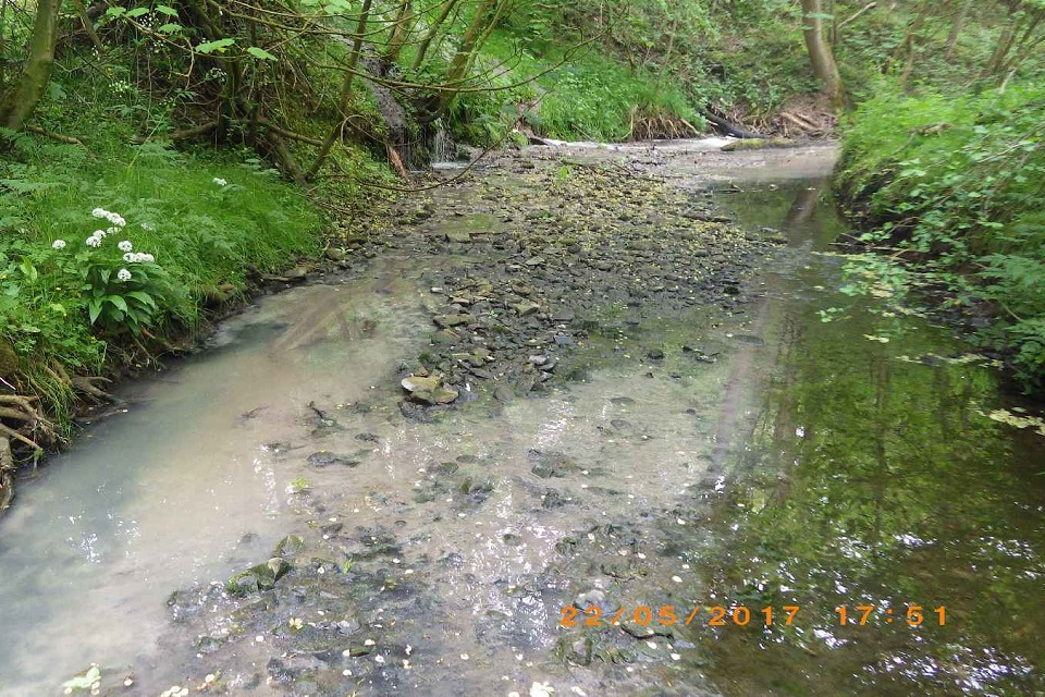 The image shows the impact on the watercourse