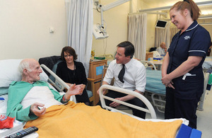 The Prime Minister meets patients in a hospital.