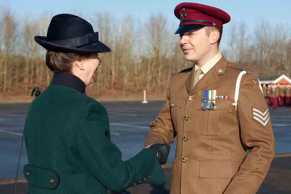 The Princess Royal presents a soldier with a medal