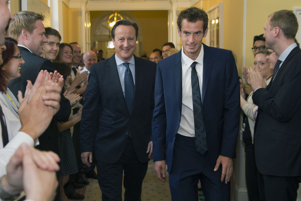 The Prime Minister leads Andy Murray through Downing Street as staff applaud