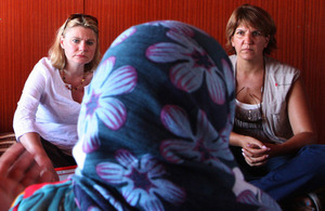 International Development Secretary Justine Greening (l), listens to a Syrian woman refugee at a Save the Children supported settlement in Lebanon's Bekaa Valley. Picture: FCO