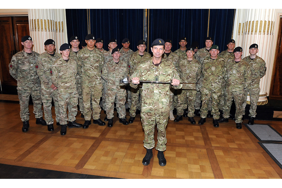 Lieutenant Colonel Tony Tait holds the Firmin Sword of Peace