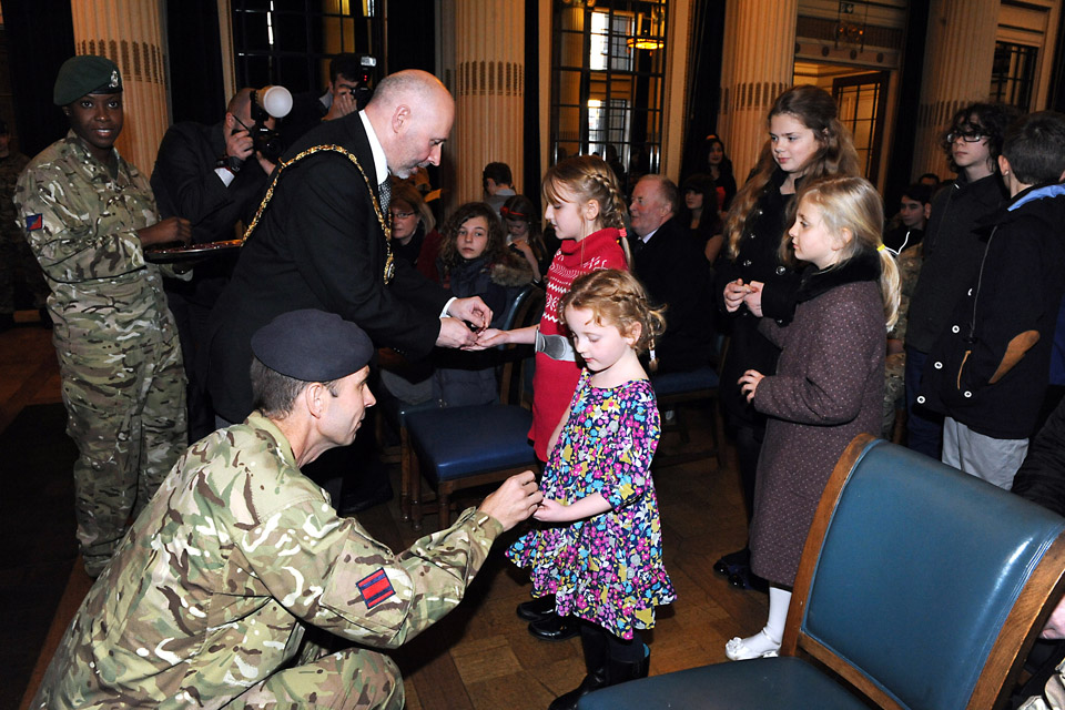 Children receive specially-commissioned medals