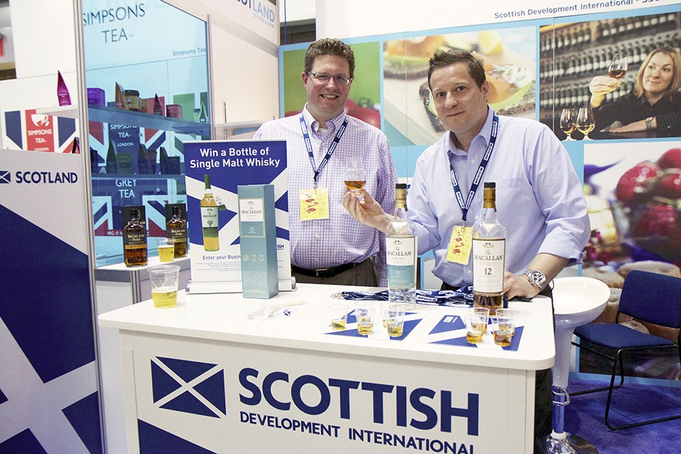 Representatives from Scottish Development International with Macallan whiskey.